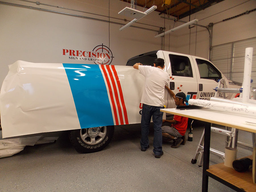 Trained professional applying a wrap - Vehicle Wraps in Fontana, Rancho, Jurupa, Riverside and Eastvale