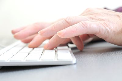 Picture of a person typing at a keyboard - advertising materials in Fontana, Rancho, Jurupa, Riverside and Eastvale